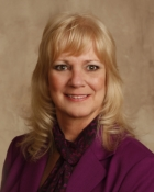 Diane Kozlowski assists buyers and sellers with Commercial and Residential Real Estate Auctions